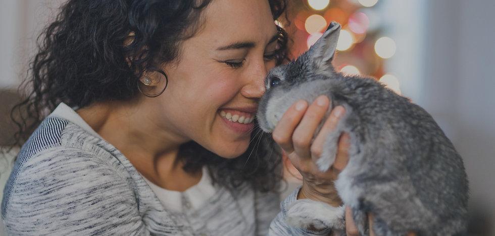 Bunnyland305 Woman holding adopted bunny