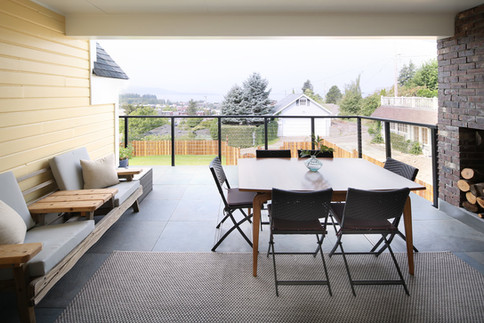 2nd floor deck w/ covered seating and wood fireplace