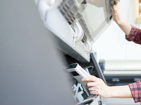 young-woman-checking-printer-SKDATCB_edi