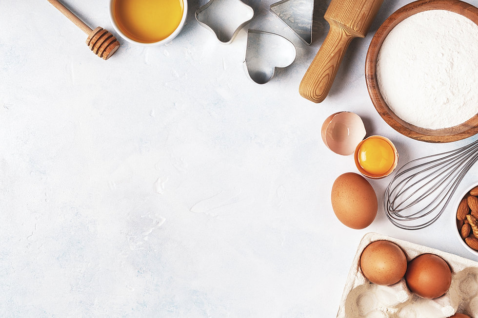 Ingredients for baking  - flour, wooden spoon, rolling pin, eggs. Top view, copy space._edited.jpg