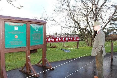 Clive Hathaway Travis inspecting Ballygawley bus bomb memorial