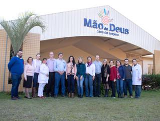 Diretores da Global Communities e da John Deere Foundation fizeram uma visita à Casa de Amparo Mão d