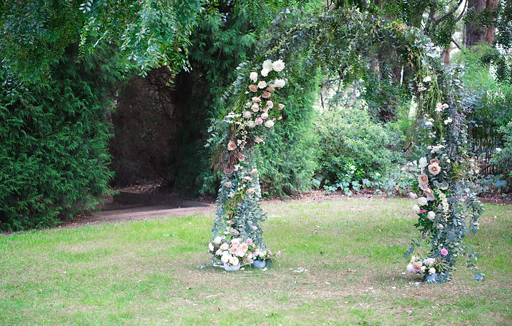 Gathered Floral fine art inspired floral wedding arch.