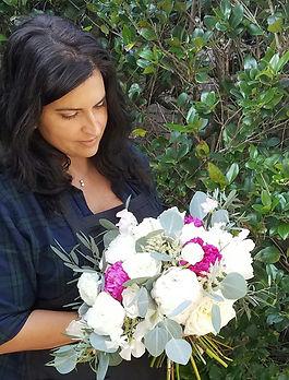 Florist with bridal bouquet
