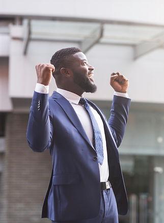 happy-black-businessman-celebrate-victor
