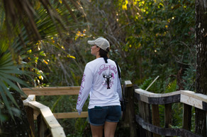 My wife enjoying a walk down a boardwalk in Big Cypress