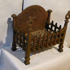 Early 20th C iron dog grate 2
