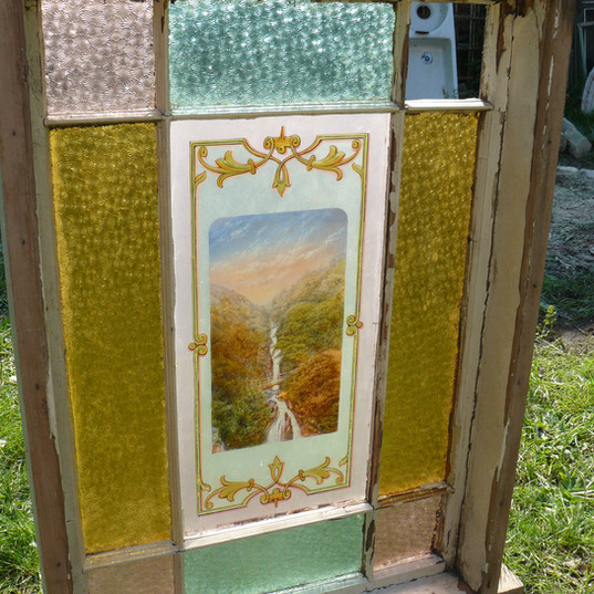 Stained glass window with central pictur