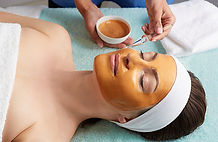 technician-applying-pumpkin-facial-mask-