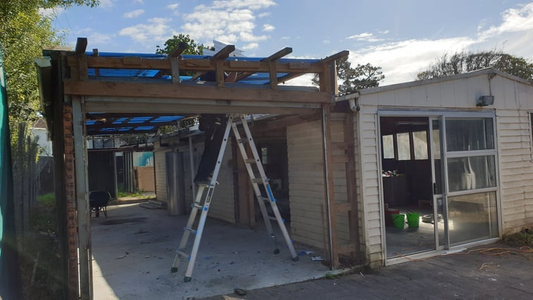 The not so pretty shed starting to demolish the carport