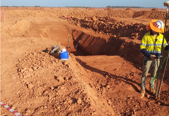Image 3: Surveying the locations of block samples tailing within a shallow excavation in mud farmed tailings