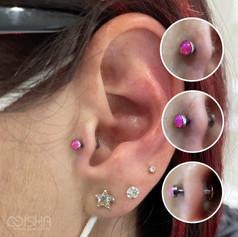 Neometal hot pink tragus piercing bu emma at isha studio.jpg