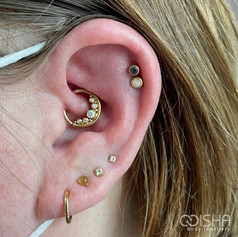 Junipurr 14ct gold Baloo daith piercing by emma at isha studio.jpg