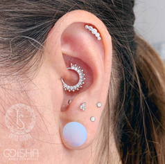 industrial strength prium cluster on a helix piercing at isha body jewellery.jpg