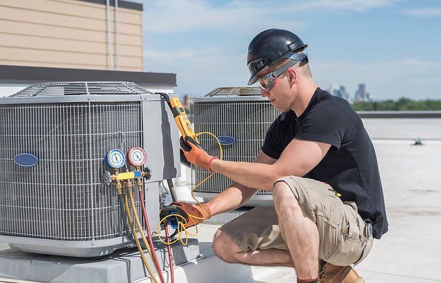 Hvac technician inspecting an condensing