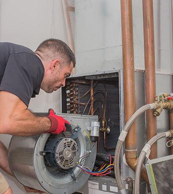 Hvac repair technician removing a blower