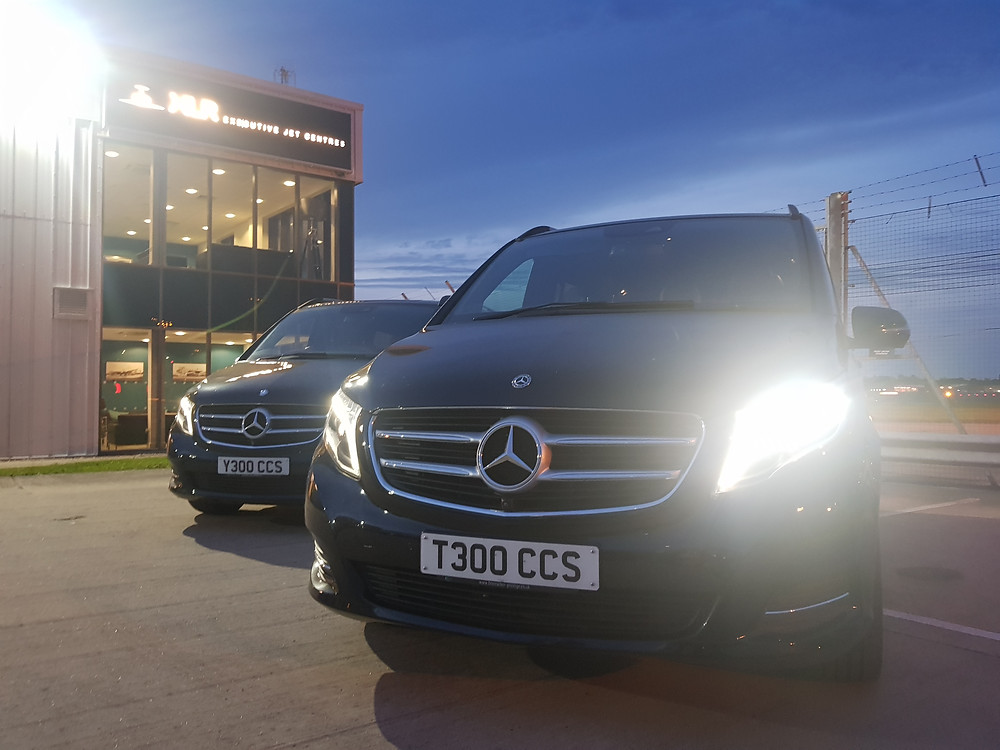 Two Central Chauffeur Services Mercedes-Benz V-Class vehicles.