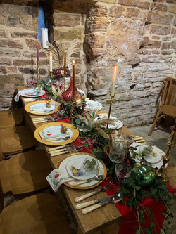 A table setting with vintage china, cutlery, glassware & napkins