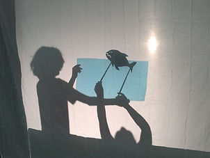 children playing with shadow puppets