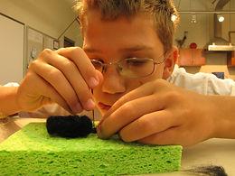 child making felt art