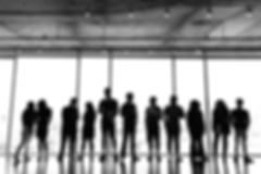 large-group-standing-in-office_edited.jp