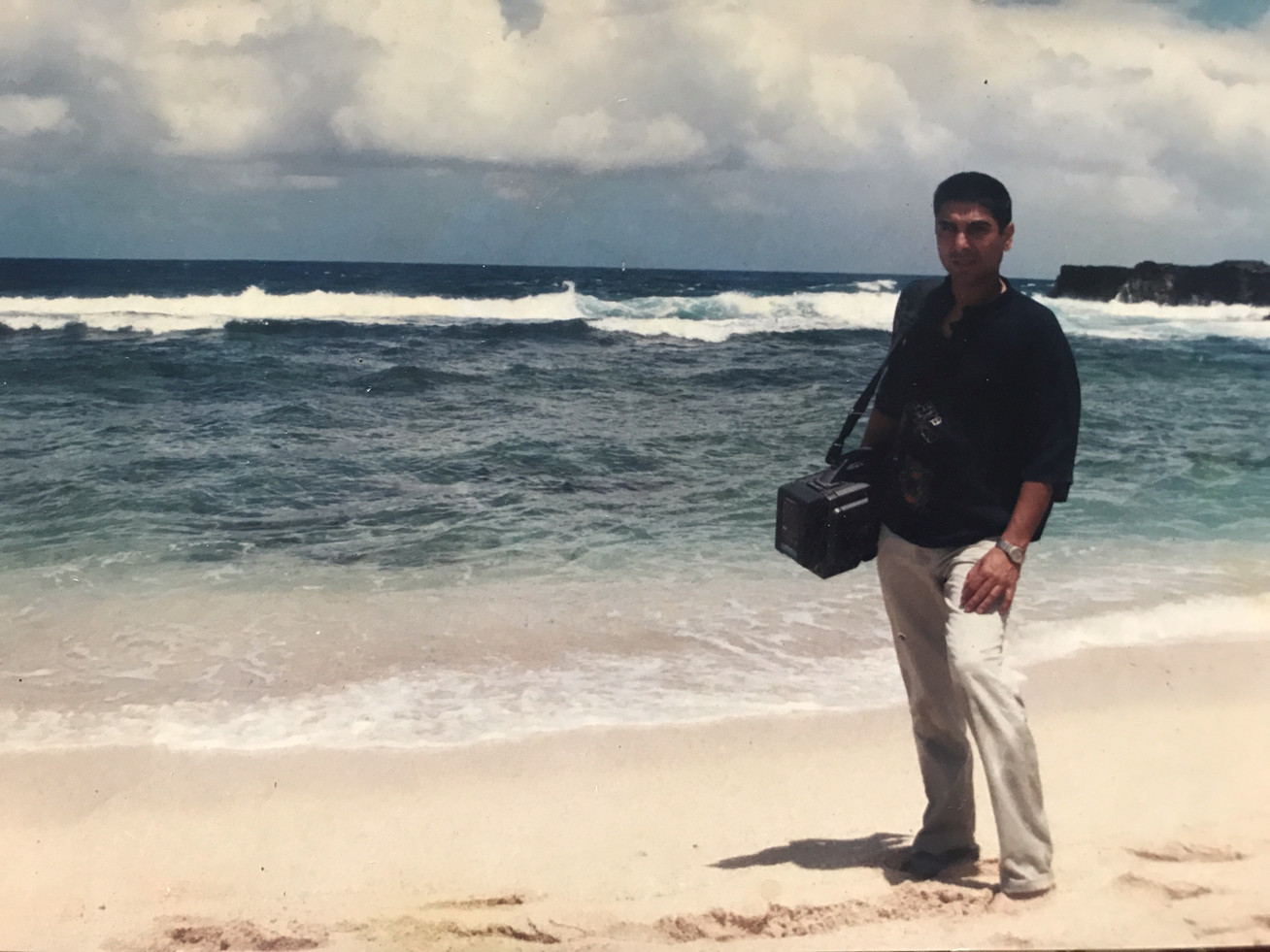 Man with professional camera on sea side - Land of Memories | Digital Documentary Film - Mauritius - Sony Betacam