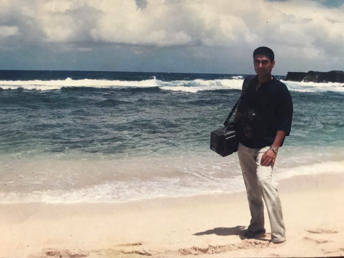 Man with professional camera on sea side - Land of Memories | Digital Documentary Film - Mauritius - Sony Betacam