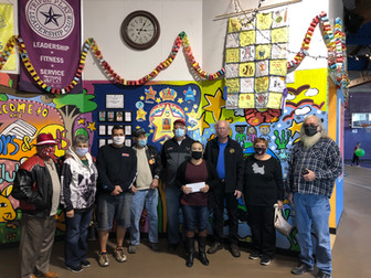 """What a great day Thursday, 10 Dec 2020 in Bisbee, Arizona!  The """"Thunder Vette Set"""" Corvette Club (TVS) of Sierra Vista presented a Charity Donation to the """"Boys & Girls Club of Bisbee.""""  Dave Stickland from TVS presented a check to Ms. Annette Flores, Chief Professional Officer in the amount of $500.00.  With Dave representing TVS was Stu Cannold, Jo Cannold, Jeff Batchelder, Jim Adrian, John Delore, Vicki Kounk, and Rick Gallagher.  They all drove their Corvettes for a mini-carshow for many of the Boys & Girls Club members (see photos)."""""""