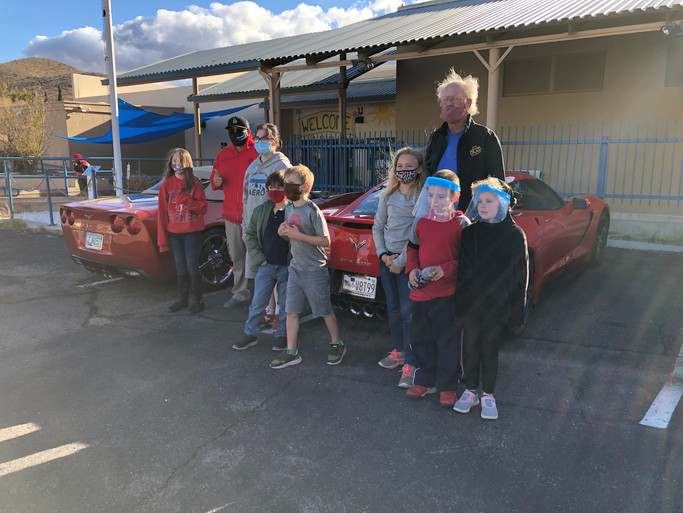 Dave Stickland with some of the Boys & Girls Club members touring the Corvettes that participated in the Charity run!