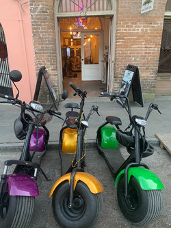 Purple, Green & Gold Electric Scooters