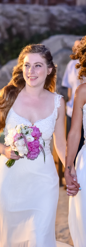two brides women white dress walk toward