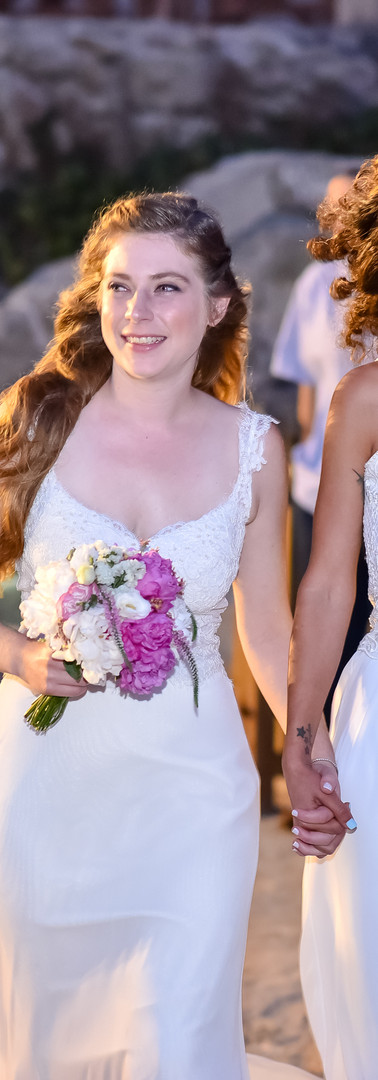two brides women white dress walk toward
