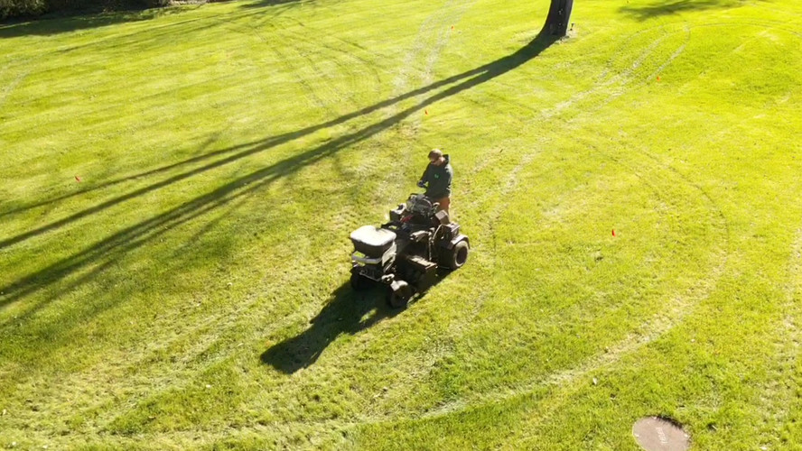 Plant Solutions actual lawn aeration in progress