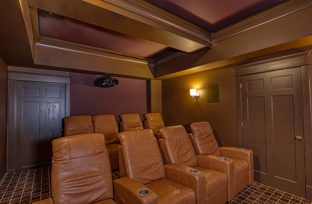 AFTER: We were able to install the rear surround speakers in the back wall and apply acoustic treatments behind color matched fabric.