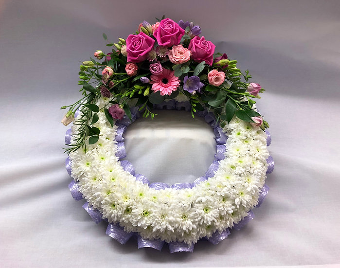 White Based Wreath with Lilac, Pink & Purple Spray