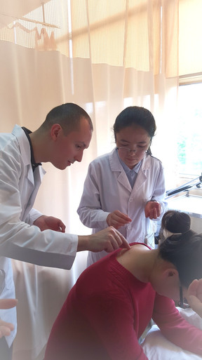 Joseph Helps Treat a Patient