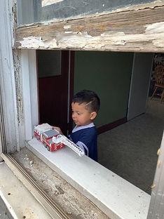 Child near Lead paint window.jfif