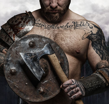 Cropped tattooed male's body with viking