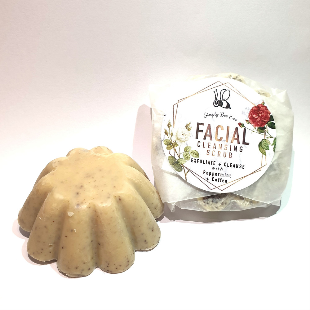 Picture shows two facial coffee scrub bars - one unwrapped, and one wrapped with the Simply Bee Eco logo and pictures of red and white roses