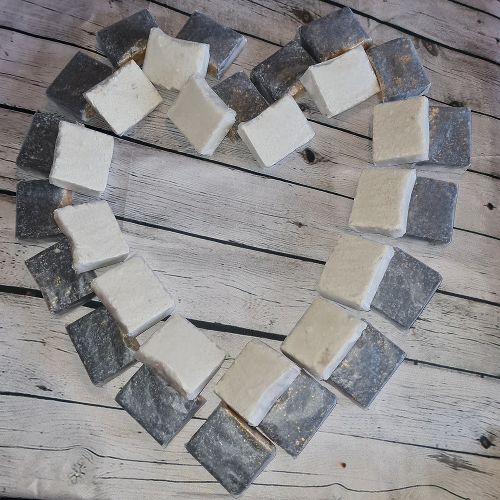 Handmade, plastic free, sulphate free shampoo bars arranged in a heart shape