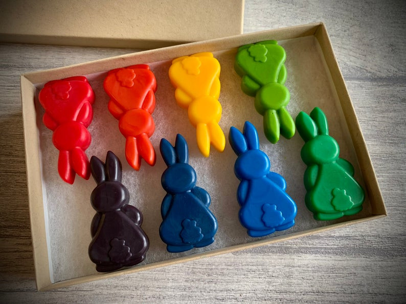 8 brightly coloured bunny shaped crayons in a gift box