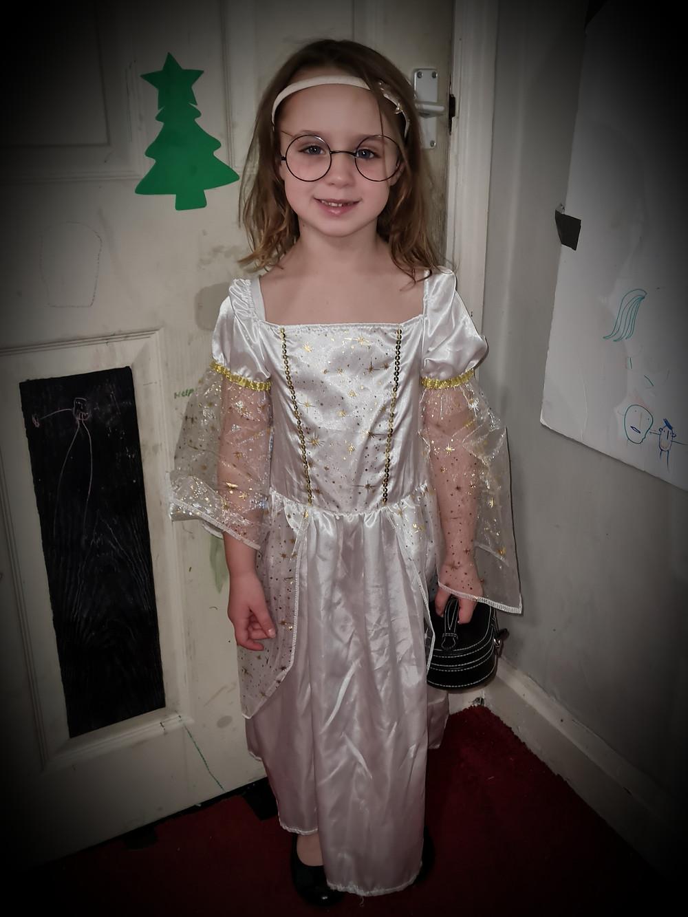 Little girl dressed in Angel Nativity costume