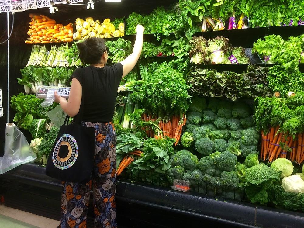 Chloe selecting Kalewearing her OFFDUTYNYC bag.