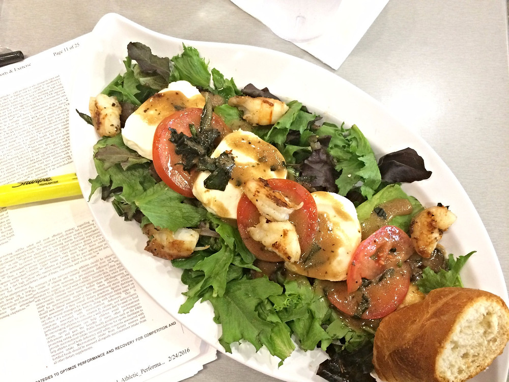 Before my 7pm return flight I enjoyed a caprese salad with grilled shrimp and water with lemon while studying for my CSSD exam.