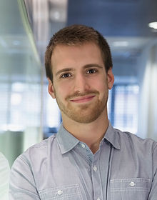 Young Man Smiling in the Office