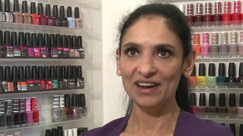 Owner (Hulya Arif) featured in front of her line of makeup