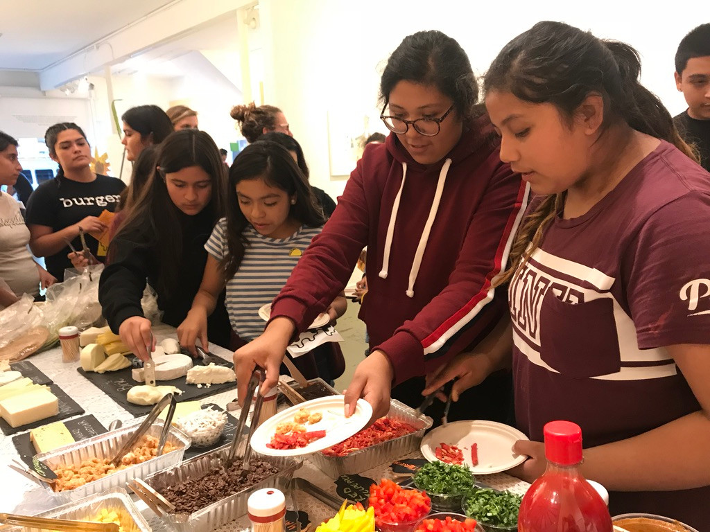 Middle school and High School students from Salinas discuss food acessibility, gentrification and LAtinx culture over quesadillas.