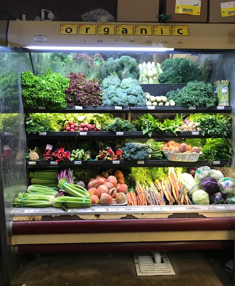 The organic produce section at Casa Lucas Market.