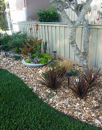 Landscaping job with rocks and plants