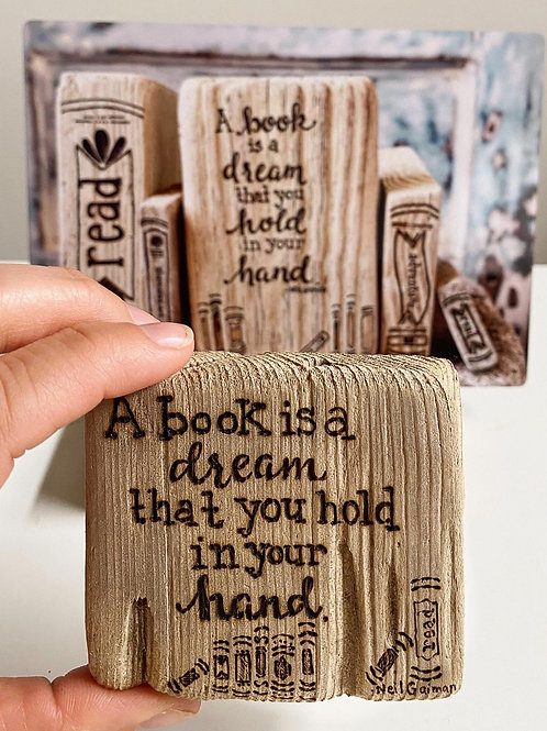 A book is a dream you hold in your hand. -